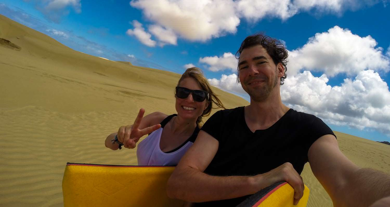 Sandboarding auf den Te Paki Dunes