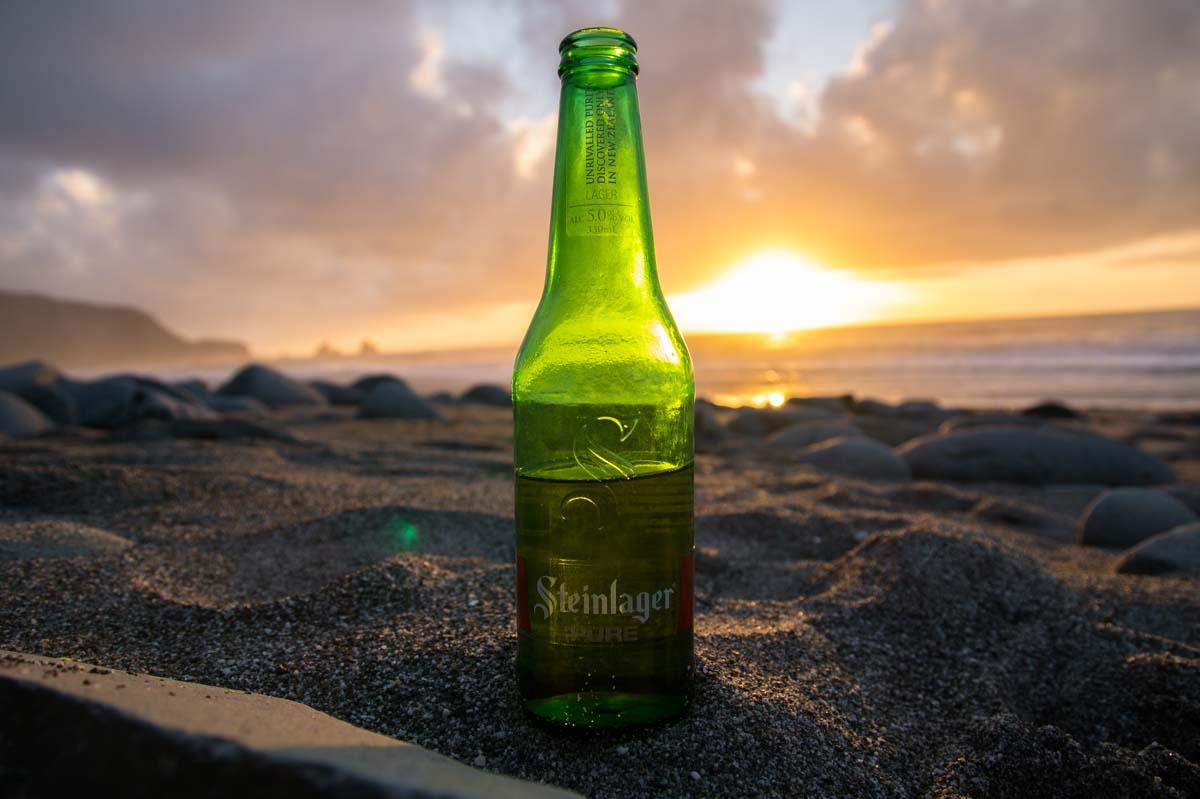 Sonnenuntergang am Strand in Neuseeland
