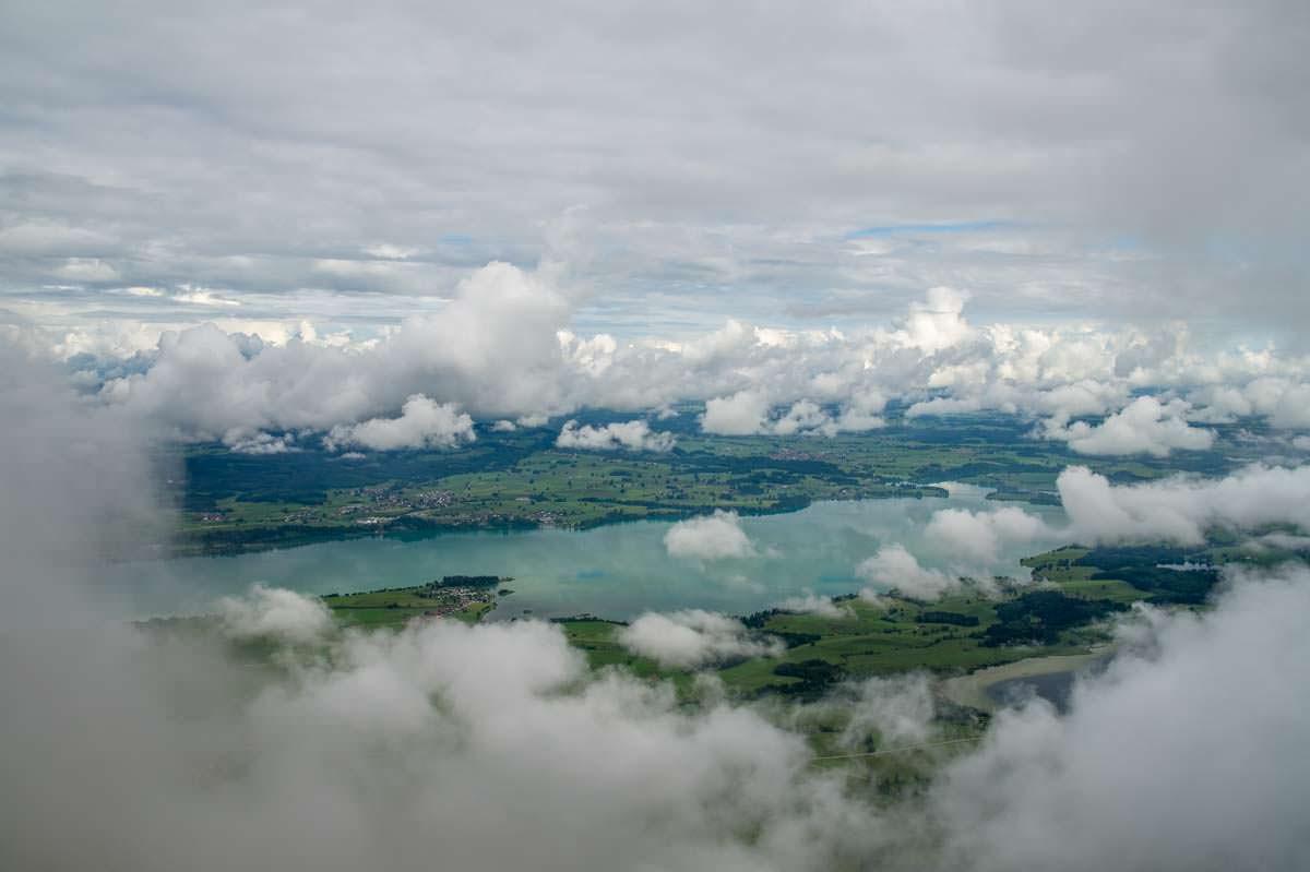 Häufig verdecken Wolken den Forggensee und den Bannwaldsee